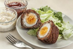 Serve scotch eggs with a green salad to balance out the heaviness of the egg.