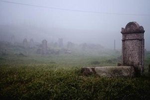 Mist covers the grave stones in an old cemetary.