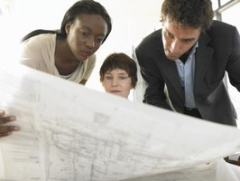 Zoning administrators looking at blueprints.