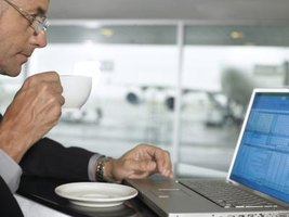 A businessman is starting his day with a cup of coffee.
