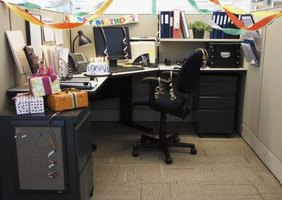 An office cubicle decorated for a birthday.