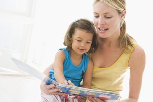 Mother reading with young child.