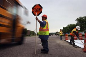 Traffic control employees have dangerous jobs that require special coordination.