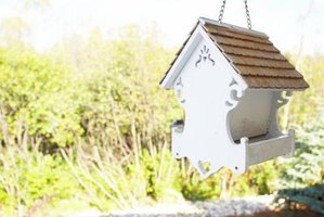 Hanging your bird feeder under a porch eave may keep it dry.