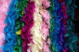 Use a thin strand from a feathered boa to finish off your fan.