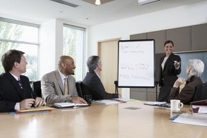 Business woman introducing new idea during business meeting.