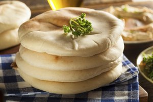 Pita bread contains yeast to leaven it, unlike tortillas.