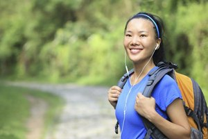 Music really does keep you energized on long walks, but it can also present a safety hazard.