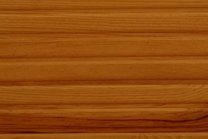 Wood planks or paneling work for basement ceilings.
