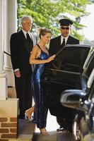 Personal drivers such as limousine drivers assist clients.
