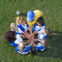 Teach kids to have fun while playing soccer, rather than emphasizing wins and losses.