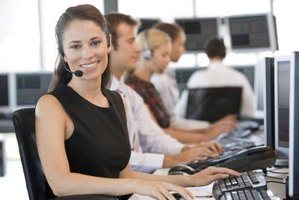 Row of order processors wearing headsets in office