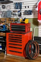 Hanging tools and equipment on slatwall can help keep shops well organized.