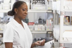 Female pharmacist filling a prescription.