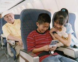 Pack a special gift  for your grandchildren to use exclusively on the flight.