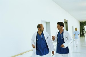 Two doctors are walking through a corridor having a discussion.