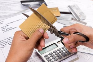 Stop using credit and develop an action plan to get out of debt.