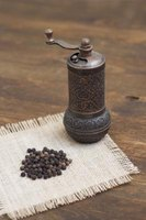 Make a paper funnel to slide peppercorns into a mill.