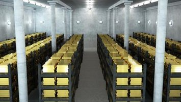 Interior of bank vault containing stacks of gold bars