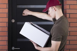 Delivery man knocking on door with parcel in hands