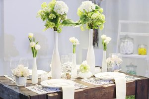 Table with centerpiece of tall and short vases.