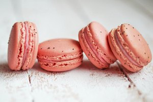 Strawberry macaroons have a few drops of red food coloring.