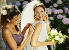The matron of honor keeps close to the bride to provide any type of assistance.