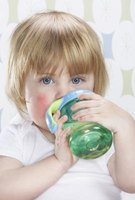 A different cup may encourage your sick toddler to drink.