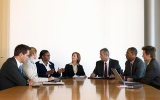 A group of executives meeting in a conference room