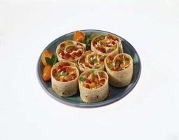 Spice up the tortilla pinwheels by adding diced peppers.