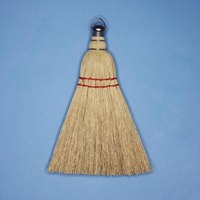 A whisk broom can make texture paint look like grass cloth.