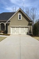 Pressure wash your concrete driveway to make it look new again.