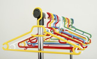 Assortment of plastic hangers on clothing rack