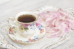 Tea cup with flower petals.