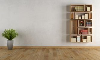 Backless wood crates fit together like a puzzle to create a bookshelf.