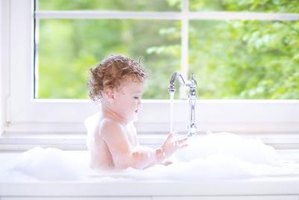 As your baby grows, his bath-time routine may need to be adjusted.