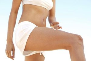 Thin, toned upper thighs come from cardio, strength training, a healthy diet and stretching exercises.