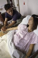 Help your wife with her breathing exercises during painful contractions.