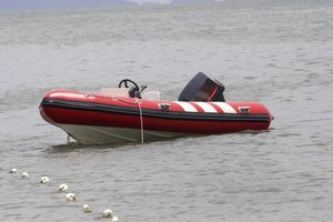 An rigid inflatable with an outboard motor.