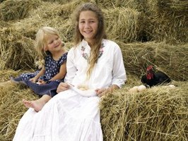 Children can assist in the care for laying hens.