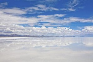 Although desolate and barren, the salt flats are a major tourist attraction.