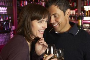 Couple flirting in bar