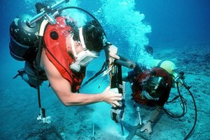 Divers work to fix an underwater cable