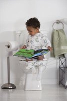 Letting your child read on the potty might help him relax.