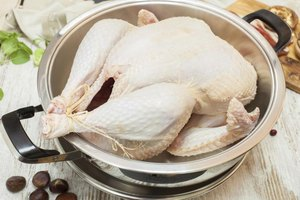 Large uncooked turkey in roasting pan