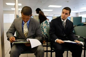 Two job candidates waiting in an office for an interview.