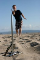 Horseshoes are easily set up at an uncrowded beach.