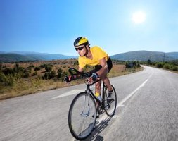 The trainer simulates the coasting and resistance of flat-road riding.
