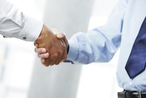 Image of two businesspeople shaking hands.