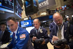 Three brokers at work at the New York Stock Exchange
